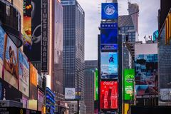 New York, Times Square. Scyscrapers, colorful neon lights and ads. USA, New York, Times Square. May 2, 2019. High modern buildings, colorful neon lights, large royalty free stock photography