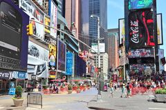New York Times Square. NEW YORK, USA - JULY 7, 2013: People visit Times Square in New York. The square at junction of Broadway and 7th Avenue has some 39 million royalty free stock image