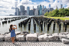 New York tourist woman taking mobile phone picture Stock Images