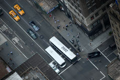 New York Traffic. A picture of a road junction in New York, USA. The overhead shot shows vehicles getting read to turn to a side road. Vehicles include buses Royalty Free Stock Image