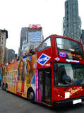 New york travel red bus. Tour bus and tourists in Times square Stock Photography