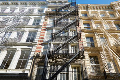 New York typical building facades with fire escape stairs Royalty Free Stock Photography