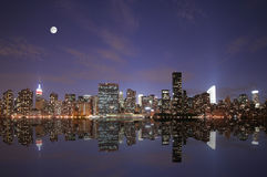 New York under the moonlight. New York City skyline under the moonlight Stock Photos