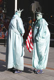 Only in New York. Unidentified street performers dressed as a Statue of Liberty at Times Square in Midtown Manhattan Royalty Free Stock Photography
