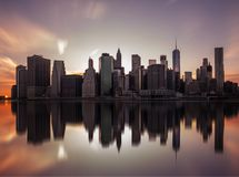 NEW YORK, UNITED STATES OF AMERICA - APRIL 28, 2017: Manhattan downtown skyline from the Brooklyn Bridge Park in New York City. Royalty Free Stock Image