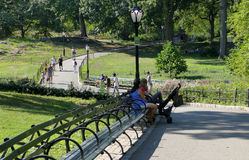 NEW YORK, UNITED STATES - AUGUST 25th, 2016:  People relaxing in Central Park on a beautiful Summer day in New York Royalty Free Stock Images