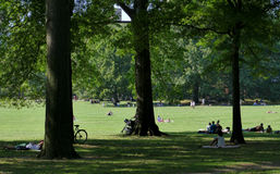 NEW YORK, UNITED STATES - AUGUST 25th, 2016:  People relaxing in Central Park on a beautiful Summer day in New York Royalty Free Stock Photography
