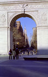 New York University Students USA. University of New York students leave Washington Square for Fifth Avenue. Empire State Building distant. Greenwich Village royalty free stock photo