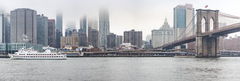 New York, US - March 29, 2018: Brooklyn bridge and downtown Man royalty free stock photo