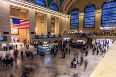 New York, US - March 28, 2018: Commuters and tourists during rush hour at the iconic Central Station in New York stock photography