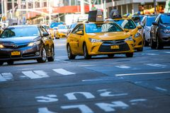 New York, US - March 31, 2018: The famous yellow taxis as seen i royalty free stock image