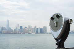 NEW YORK, US - NOVEMBER 22: Binocular viewers with Manhattan sky Royalty Free Stock Images