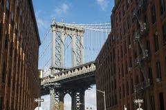 NEW YORK, US - NOVEMBER 24: Brooklyn Bridge framed between brick Royalty Free Stock Image