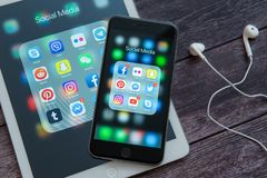 Apple iPad and iPhone with icons of social media. Social media icons. Marketing concept. stock photos