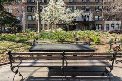 NEW YORK, USA - APRIL 14, 2018: Wooden table and bench in the Park. West Village, New York