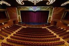 Cinema theatre in Disney Fantasy ship. New york, USA - April 27, 2015: Cinema theatre in Disney Fantasy ship panoramic view royalty free stock image