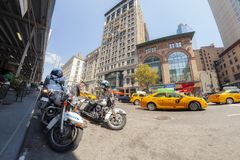 Fisheye lens picture of Police patrol motorcycles parked at the 5th Avenue. New York, USA - August 15, 2015: Fisheye lens picture of Police patrol motorcycles royalty free stock images