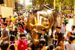 NEW YORK, USA - August 31, 2018: Tourists near the bronze bull statue on wall street in new york.  royalty free stock photo