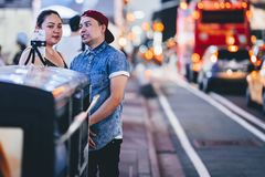 New York, USA - August 3, 2018: Young couple smiling and taking selfie in Time Square royalty free stock image