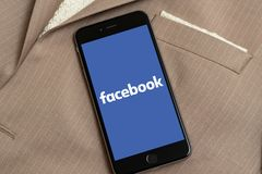 Black Apple iPhone with logo of social media Facebook Messenger on the screen. stock image