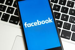 Black iPhone with logo of social media Facebook on the screen. stock images