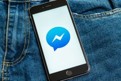 Black phone with logo of social media Facebook Messenger on the screen. stock image