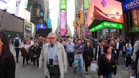 New York, USA. Close up of thousands of people walking in Time Square, Broadway and on the seventh Avenue
