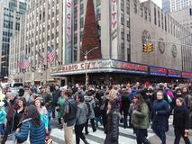 New York, USA, December 3, 2016: People crossing street in front of Radio City Music Hall royalty free stock photography