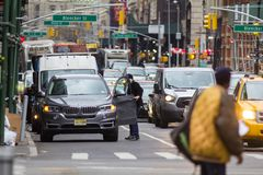 NEW YORK, USA - Decembre 2017: busy road in a big city with lots of cars and people. Urban landscape Royalty Free Stock Photo