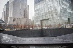 NEW YORK, USA - FEBRUARY 23, 2018: Panorama of Ground Zero with the names of the victims of September 11 at the center of Wall royalty free stock photography