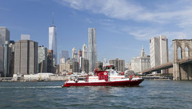NEW YORK, USA - The fire boat No.343 on East River. New York, USA - September 28, 2014: The fire boat No.343 on East River at lower Manhattan. Named in honor of stock image
