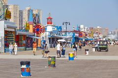 Coney Island famous boardwalk on a sunny day. royalty free stock images