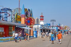 NPeople at the Coney Island boardwalk on a sunny day. stock image