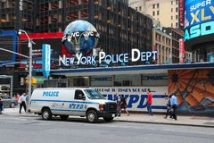 New York Police Department. NEW YORK, USA - JULY 2, 2013: People walk by New York Police Department (NYPD) at Times Square in New York. NYPD employs 34,500 Royalty Free Stock Photo
