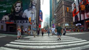 New York, USA - 04 july, 2018: Street going through Times Square day New York City. New York, USA - 04 july, 2018: People walking and traffic going through New Stock Photography