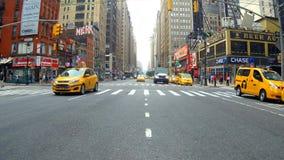 New York, USA - 04 july, 2018: Taxi in traffic of Manhattan establishing shot of New York City, New York. New York, USA - 04 july, 2018: Yellow Taxi in traffic Stock Images