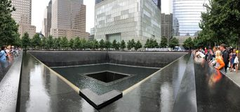 New York, USA - July 19, 2018: Tourists visiting National September 11 Memorial in Manhattan, NYC Stock Photography