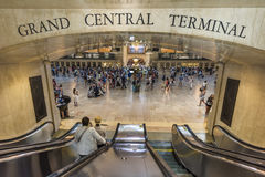 New York, USA - June 19, 2016: Bustling grand central terminal in New York City with sign and view from escalator Royalty Free Stock Images