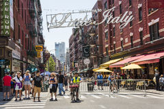 New York, USA - June 18, 2016: Busy street with pedestrians in Little Italy with a welcome sign in New York City Royalty Free Stock Image