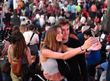 New York, USA - June 10, 2018: Couple makes selfie on a smartphone at Times Square in New York. royalty free stock photos