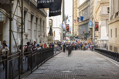 New York, USA - June 18, 2016: Fenced off New York Stock Exchange with people walking on Wall Street Royalty Free Stock Photos