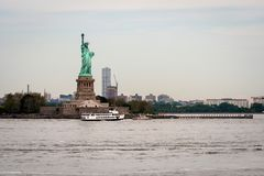 New York, USA - June 7, 2019: Ferry Boat approaching the Statue of Liberty, Liberty Island - Image. New York, USA - June 7, 2019: Ferry Boat approaching the stock photography
