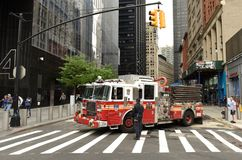 New York, USA - June 10, 2018: Firefighters and fire truck near royalty free stock image
