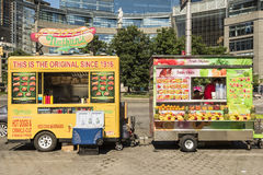 New York, USA - June 18, 2016: Hot dog and smoothie food trucks on Columbus Circle in New York City Stock Image
