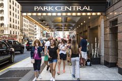 New York, USA - June 18, 2016: Park Central hotel in New York city with people walking Stock Images