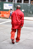 NEW YORK, USA - JUNE 15, 2015 - Red dressed black man walking in Harlem on weekday Stock Images