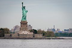 New York, USA - June 7, 2019: Statue of Liberty, Liberty Island, with Manhattan in the background - Image. New York, USA - June 7, 2019: Statue of Liberty stock photo