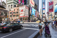 New York, USA - June 18, 2016: Times Square during the day with advertisements, pedestrians and stores Royalty Free Stock Images