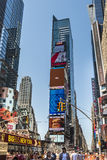 New York, USA - June 18, 2016: Times Square during the day with advertisements, pedestrians and stores Stock Photos