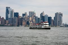 New York, USA - June 7, 2019:  Tourist boats on East River in front of Manhattan, A East River ferry boat travels the Hudson River royalty free stock photos
